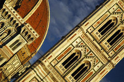 Detail of the duomo of Firenze. Detail of the tower and cupola of duomo with blue sky royalty free stock photo