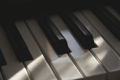 The detail of dusty cinematic old electronic piano keyboard royalty free stock image