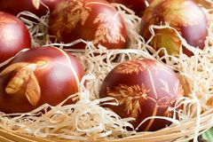 Detail of Easter eggs dyed with onion peels with a pattern of fr stock photo