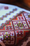 Detail of an Eastern European national pattern on a white towel stock image