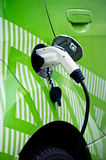 Detail of ecological car re-fuelling, plugged in. Detail of ecological green car re-fuelling, plugged in Royalty Free Stock Photos