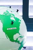 Detail of education globe for childs with braille writing. North. Close up of world map globe. Focus in North America royalty free stock image