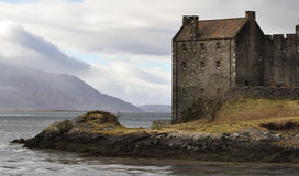 Detail Eilean Donan Castle. Detail of Eilean Donan Castle with a view at the scenic landscape at the beginning of march stock photography