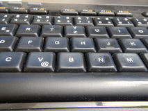 Detail einer schwarzen Computertastatur Stockbilder