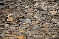Detail einer Wand eines alten Steinhauses Lizenzfreie Stockfotos