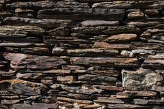 Detail einer Wand eines alten Steinhauses Lizenzfreies Stockfoto