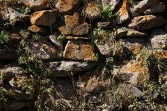 Detail einer Wand eines alten Steinhauses Lizenzfreies Stockbild