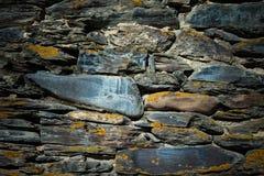 Detail einer Wand eines alten Steinhauses getont Lizenzfreies Stockfoto