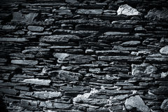Detail einer Wand eines alten Steinhauses getont Lizenzfreies Stockbild