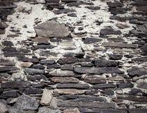 Detail einer Wand eines alten Steinhauses getont Stockfoto