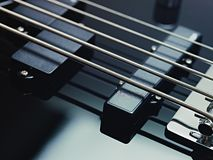 Detail of electric bass, pickups and cords Stock Images