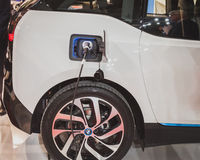 Detail of an electric car under charge at Solarexpo 2014 in Milan, Italy Stock Photography