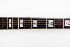 Detail of electric guitar neck and frets Royalty Free Stock Photos