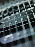 Detail of electric guitar, pickups and cords Stock Photos