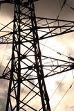 Detail of Electrical Pylon. Silhouetted, detail of electrical pylon against broken cloud and blue sky stock photo