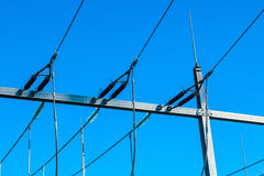 Detail of Electrical pylons under clear blue sky Royalty Free Stock Photos