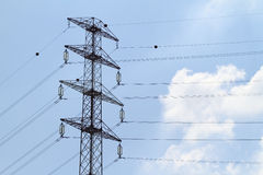 Detail of electricity pylon against Royalty Free Stock Photos