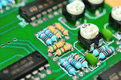 Detail of an electronic printed circuit board Stock Photos