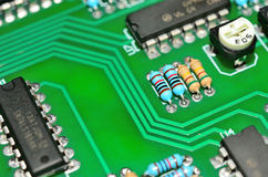 Detail of an electronic printed circuit board. With many electrical components Stock Image