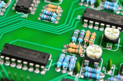 Detail of an electronic printed circuit board. With many electrical components Royalty Free Stock Photo