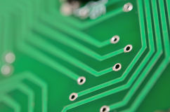 Detail of an electronic printed circuit board. With many electrical components Stock Photos