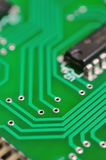 Detail of an electronic printed circuit board. With many electrical components Stock Photography