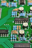 Detail of an electronic printed circuit board. With many electrical components Royalty Free Stock Images