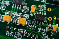 Detail of an electronic printed circuit board. With many electrical components Royalty Free Stock Image
