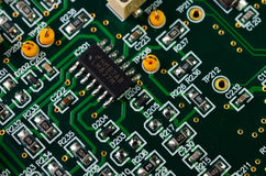 Detail of an electronic printed circuit board. With many electrical components Royalty Free Stock Photos
