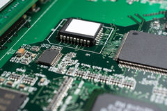 Detail of an electronic printed circuit board. With many electrical components Stock Images