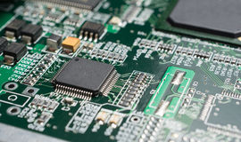 Detail of an electronic printed circuit board. With many electrical components Royalty Free Stock Photography