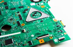 Detail of an electronic printed circuit board with many electrical components. Creative abstract electronic industry business technology concept: macro view of stock photos