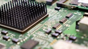 Electronic printed circuit board with many electrical components. Detail of an electronic printed circuit board with many electrical components Stock Photography
