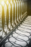 Detail of the an embankment railing. Focus in the center of the frame, shallow depth of field. Toned image Royalty Free Stock Photos