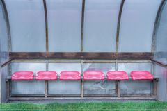 Empty spare bench next to a soccer field stock image
