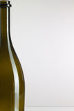 Detail of empty wine bottle. On a white background Stock Photos