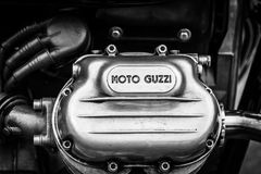 Detail of a engine of the Italian motorcycle Moto Guzzi V7. BERLIN, GERMANY - MAY 17, 2014: Detail of a engine of the Italian motorcycle Moto Guzzi V7. Black and Royalty Free Stock Image