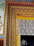 Karma Tharjay Chokhorling Tibetan Monastery Bodh Gaya India. Detail of entrance decorative painting at the Karma Tharjay Chokhorling Tibetan Monastery, Buddhist Royalty Free Stock Images