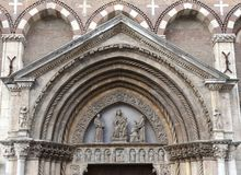 Detail of the entrance door of the ancient Christian Church. In an european city stock photo