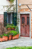 Detail of an Entrance Door in Venice. Detail of an old house's entrance door in Venice, Italy Royalty Free Stock Photos