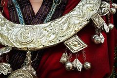 Detail of ethnic minorities neckless. Detail of red ethnic minorities costume and silver traditional neckless from china stock images