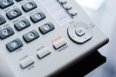 Detail of executive VoIP desk phone buttons. Shallow depth of field - focus on the center of the phone Royalty Free Stock Photo