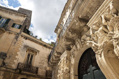 Detail of the exterior facade of a historic baroque palace in Salento - Italy. Detail of the exterior facade of a historic baroque palace with statues and Royalty Free Stock Image