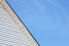 Detail of the exterior facade house roof trimmed siding Royalty Free Stock Images