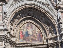 Mosaic Icon, Florence Cathedral, Italy. Detail of the exterior of the Florence Roman Catholic Cathedral, or Duomo, featuring a colourful ecclesiastical icon Stock Image