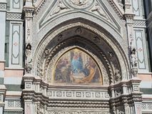 Mosaic Icon, Florence Cathedral, Italy. Detail of the exterior of the Florence Roman Catholic Cathedral, or Duomo, featuring a colourful ecclesiastical icon Stock Images