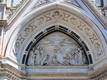 Bas Relief Icon, Florence Cathedral, Italy. Detail of the exterior of the Florence Roman Catholic Cathedral, or Duomo, featuring a marble bas relief sculptural Stock Images