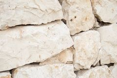 It is a detail of an exterior wall of stone factory placed in dry. stock photos