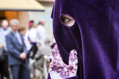 Detail of eye of penitence during a Holy week procession Royalty Free Stock Image