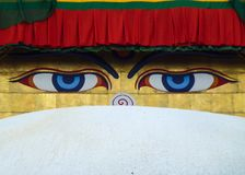 The eyes of Buddha painted over the dome of the Boudhanath Stupa, Kathmandu, Nepal. Detail of the eyes of Buddha painted over the dome of the Boudhanath Stupa royalty free stock photo